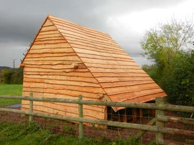 Round wood timber framed building - from local sustainably managed on construction house designs, timber frame cottage, timber frame home, timber frame kitchen, timber frame ideas, timber frame landscaping, timber frame additions, timber frame interior design, timber frame lighting, timber frame ceiling, roof house designs, timber frame books, timber frame bathroom, landscaping house designs, timber frame construction, timber home designs, timber frame bedroom, post frame house designs, timber frame furniture, timber frame living room,